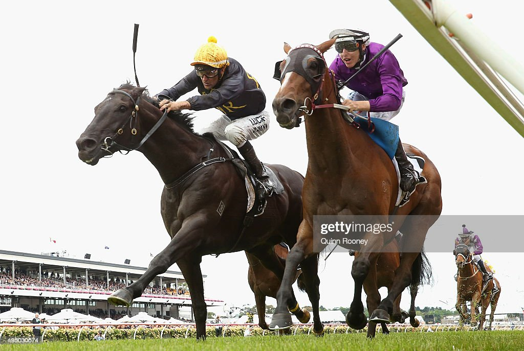 Jockey Dwayne Dunn riding Excess Knowledge leads Damien Lane riding Zanteca across the line to win race 5 The Lexus Stakes on Derby Day at Flemington...