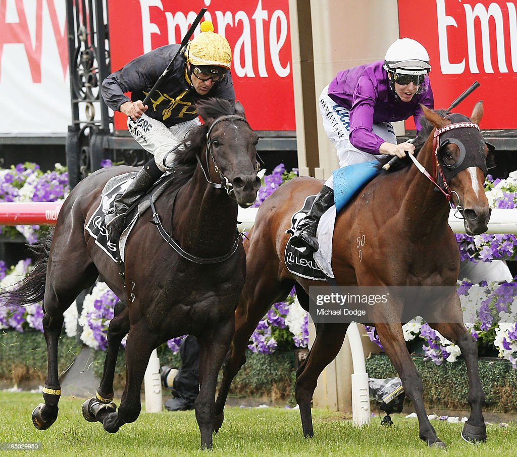 Jockey Dwayne Dunn riding Excess Knowledge wins against Damian Lane riding Zanteca in race 5 The Lexus Stakes on Derby Day at Flemington Racecourse...