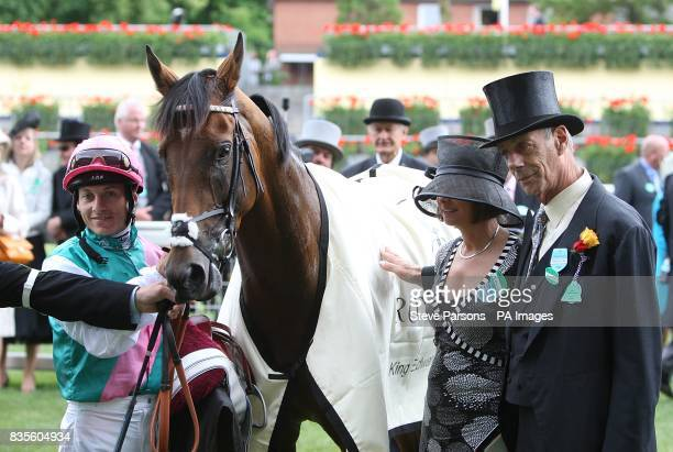 Jockey Eddie Ahern after winning the King Edward VII Stakes on Father Time with trainer Henry Cecil at Ascot Racecourse Berkshire