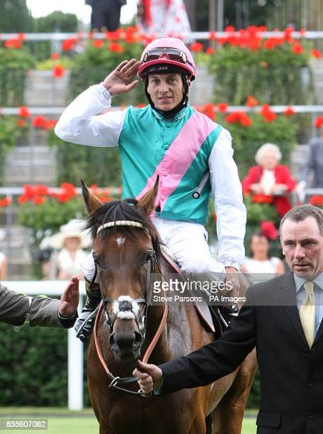 Jockey Eddie Ahern celebrates after winning the King Edward VII Stakes on Father Time at Ascot Racecourse Berkshire