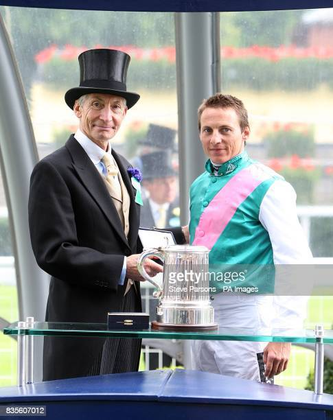 Jockey Eddie Ahern with Charlie Watts after winning the King Edward VII Stakes on Father Time at Ascot Racecourse Berkshire