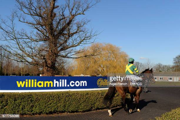 Jockey Felix de Giles on Busy Isit leave the pre parade ring prior to The William Hill App 25 SignUp Bonus Handicap Steeple Chase