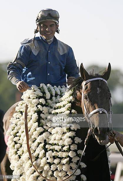 Jockey Fernando Jara aboard Jazil wins the 138th running of the Belmont Stakes at Belmont Park in Elmont NY on June 10 2006