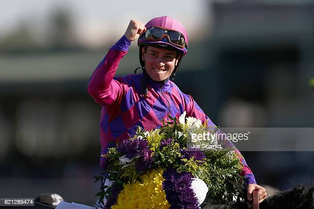 Jockey Flavien Prat riding Obviously celebrates after winning the Turf Sprint race on day two of the 2016 Breeders' Cup World Championships at Santa...