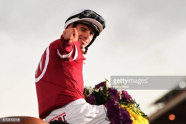 Jockey Florent Geroux celebrates after riding Gun Runner to a win in the Breeders' Cup Classic on day two of the 2017 Breeders' Cup World...