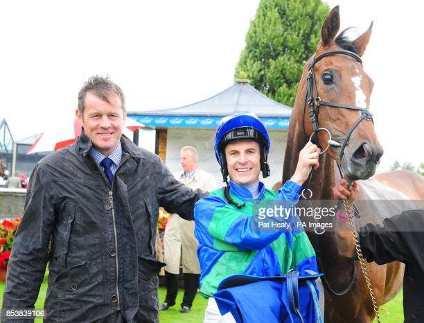Jockey Fran Berry and trainer Andy Oliver with Run The Red Light after winning the Loder EBF Fillies Race at Curragh Racecourse County Kildare