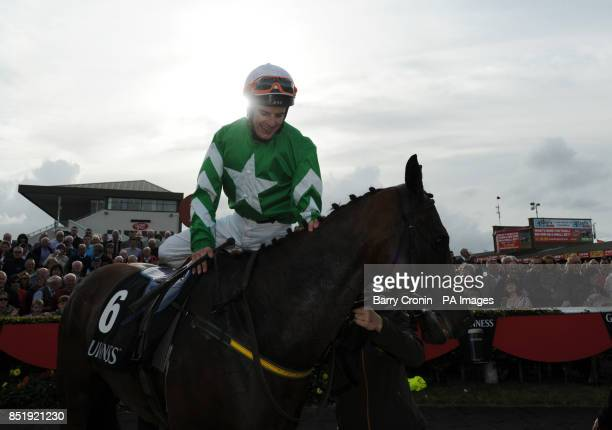 Jockey Fran Berry celebrates riding Curley Bill to victory in the Guinness Handicap during day five of the 2013 Galway Summer Festival at Galway...