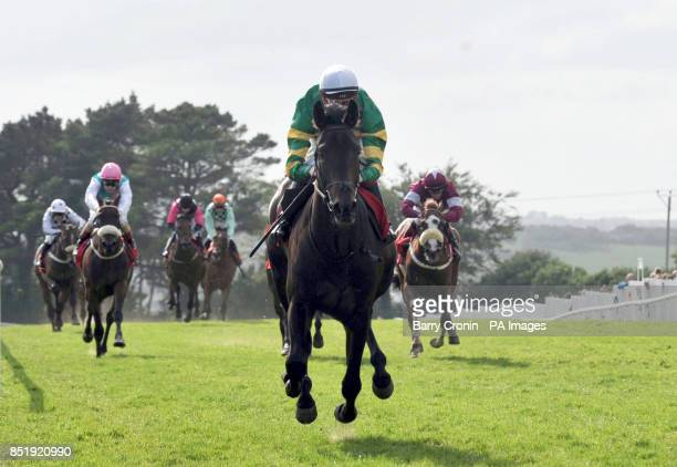 Jockey Fran Berry rides Hidden Oasis to victory in the Guinness 1759 European Breeders Fund Median Auction Maiden during day five of the 2013 Galway...