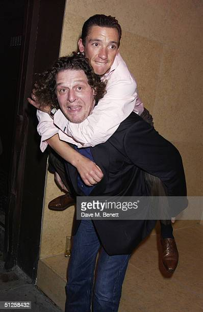Jockey Frankie Dettori and chef Marco Pierre White attend the preopening party for their new bar venture 'Frankie's Bar' on September 2 2004 in London