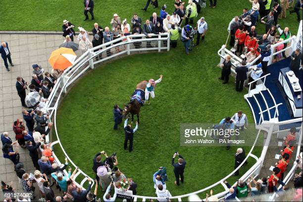 Jockey Frankie Dettori celebrates after his winning ride on Enable in the Investec Oaks on Ladies Day during the 2017 Investec Epsom Derby Festival...