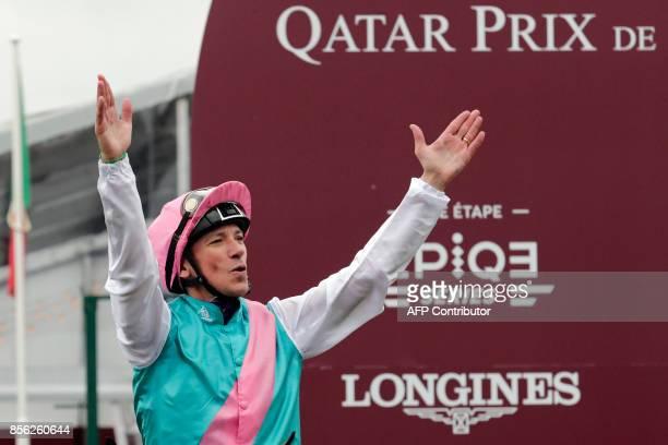 Jockey Frankie Dettori celebrates after winning the Qatar Prix de l'Arc de Triomphe horse race at the Chantilly racecourse north of Paris on October...