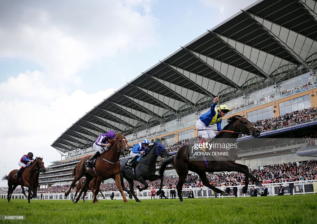Jockey Frankie Dettori celebrates as he crosses the finishing post riding Across The Stars to win The King Edward VII Stakes group 2 race during day...