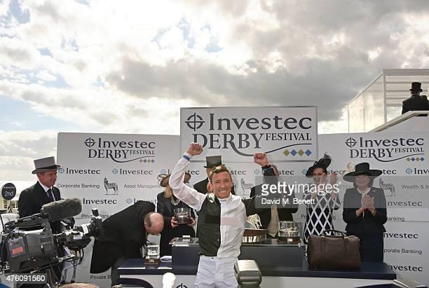 Jockey Frankie Dettori celebrates winning The Investec Derby at Derby Day during the Investec Derby Festival at Epsom Racecourse on June 6 2015 in...