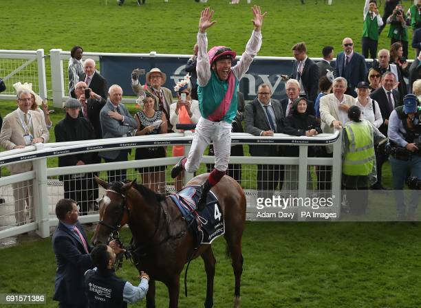 Jockey Frankie Dettori celebrates winning the Investec Oaks on Enable on Ladies Day during the 2017 Investec Epsom Derby Festival at Epsom Racecourse...