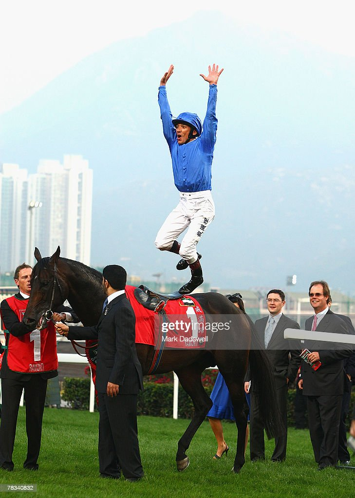 Jockey Frankie Dettori celebrates with a star jump from Ramonti after winning the Cathay Pacific Hong Kong Cup during the Cathay Pacific Hong Kong...