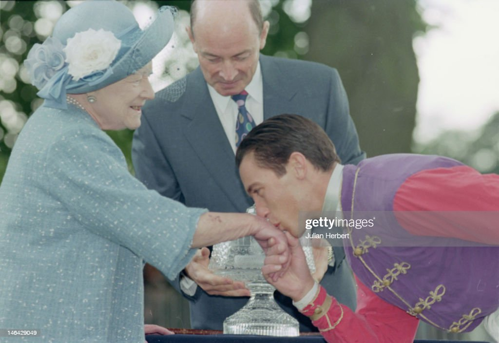 Jockey Frankie Dettori kissing the hand of the Queen Mother at Ascot, 21st June 1997.