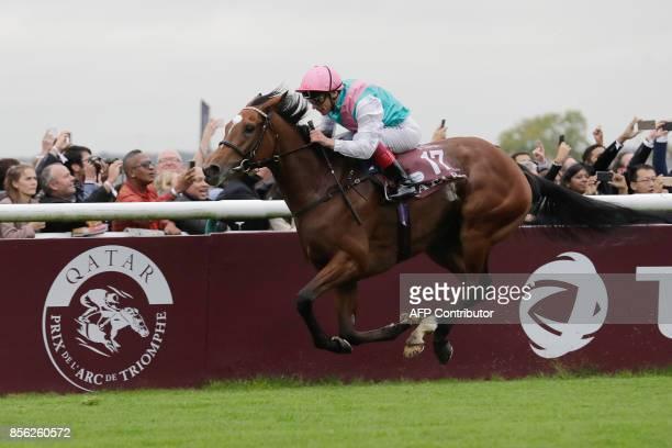 Jockey Frankie Dettori on his horse Enable owner Prince Khalid Abdullah crosses the finish line to win the 96th Qatar Prix de l'Arc de Triomphe horse...