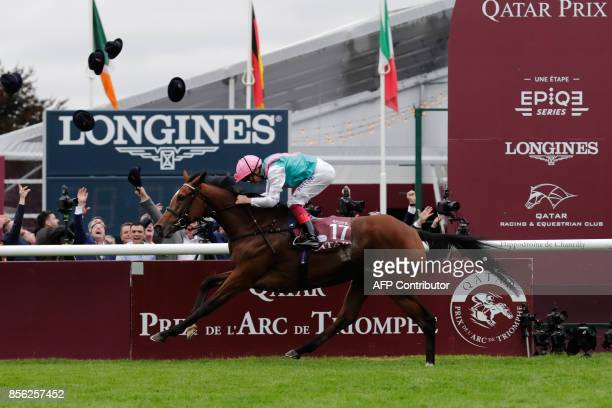 Jockey Frankie Dettori on his horse Enable races to win the 96th Qatar Prix de l'Arc de Triomphe horse race at the Chantilly racecourse north of...