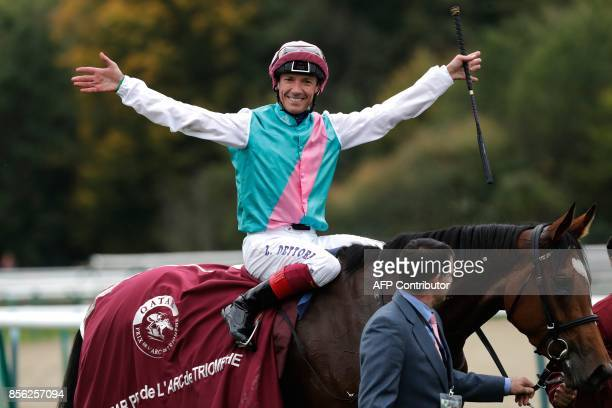 Jockey Frankie Dettori on his horse Enable reacts as he celebrates winning the 96th Qatar Prix de l'Arc de Triomphe horse race at the Chantilly...