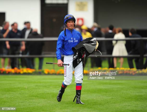 Jockey Frankie Dettori walks back to the saddleing enclosure after his race