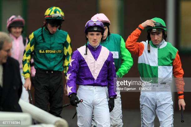 Jockey Freddie Tylicki leads out his peers for the start of the Bet At Blue Square On Your Mobile Handicap