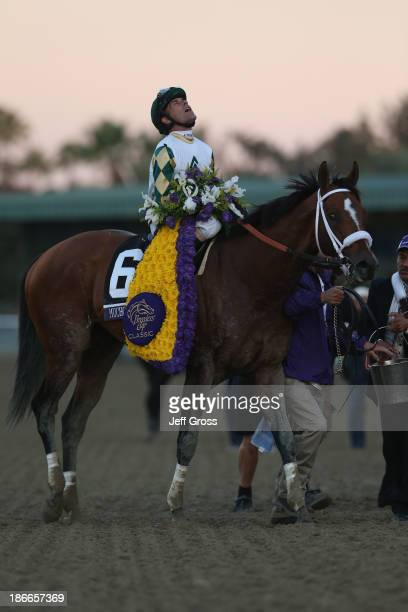 Jockey Gary Stevens exhales atop Mucho Macho Man after winning the Classic during the 2013 Breeders' Cup World Championships at Santa Anita Park on...
