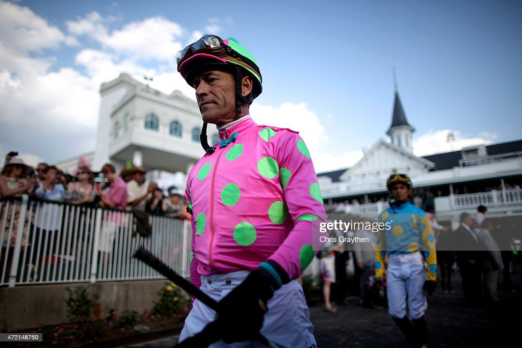 Jockey <a gi-track='captionPersonalityLinkClicked' href=/galleries/search?phrase=Gary+Stevens+-+Jockey&family=editorial&specificpeople=15617910 ng-click='$event.stopPropagation()'>Gary Stevens</a> of Firing Line #10 walks ahead of Jockey <a gi-track='captionPersonalityLinkClicked' href=/galleries/search?phrase=Victor+Espinoza&family=editorial&specificpeople=241557 ng-click='$event.stopPropagation()'>Victor Espinoza</a> of American Pharoah #18 in the paddock area prior to the 141st running of the Kentucky Derby at Churchill Downs on May 2, 2015 in Louisville, Kentucky.