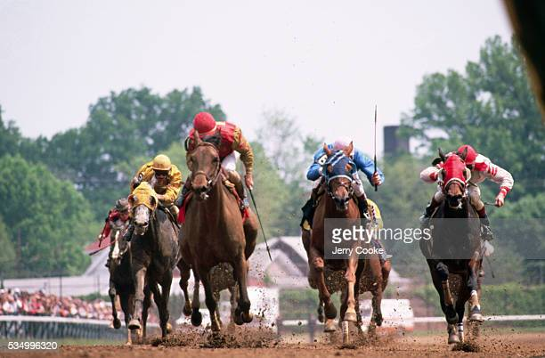 Jockey Gary Stevens rides Thunder Gulch towards the finish line and wins the 1995 Kentucky Derby at Churchill Downs in Louisville Kentucky