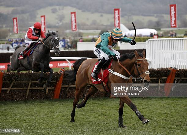 Jockey Gavin Sheehan riding Cole Harden after jumping the last hurdle on his way to winning The Ladbrokes World Hurdle Race during the third day of...