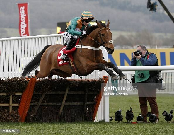 Jockey Gavin Sheehan riding Cole Harden jumps a hurdle during The Ladbrokes World Hurdle Race on the third day of the Cheltenham Festival horse...