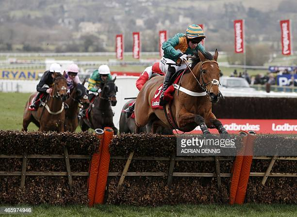 Jockey Gavin Sheehan riding Cole Harden while jumping the last hurdle on his way to winning The Ladbrokes World Hurdle Race during the third day of...