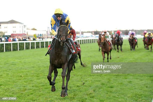 Jockey George Baker rides Litigant to victory during the Betfred November Handicap Stakes on November 7 2015 in Doncaster England