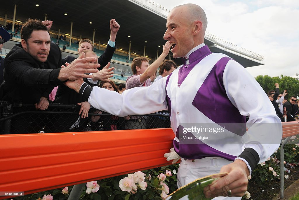 Jockey <a gi-track='captionPersonalityLinkClicked' href=/galleries/search?phrase=Glen+Boss&family=editorial&specificpeople=194758 ng-click='$event.stopPropagation()'>Glen Boss</a> celebrates with the crowd after winning the Sportingbet Cox Plate during Cox Plate Day at Moonee Valley Racecourse on October 27, 2012 in Melbourne, Australia.