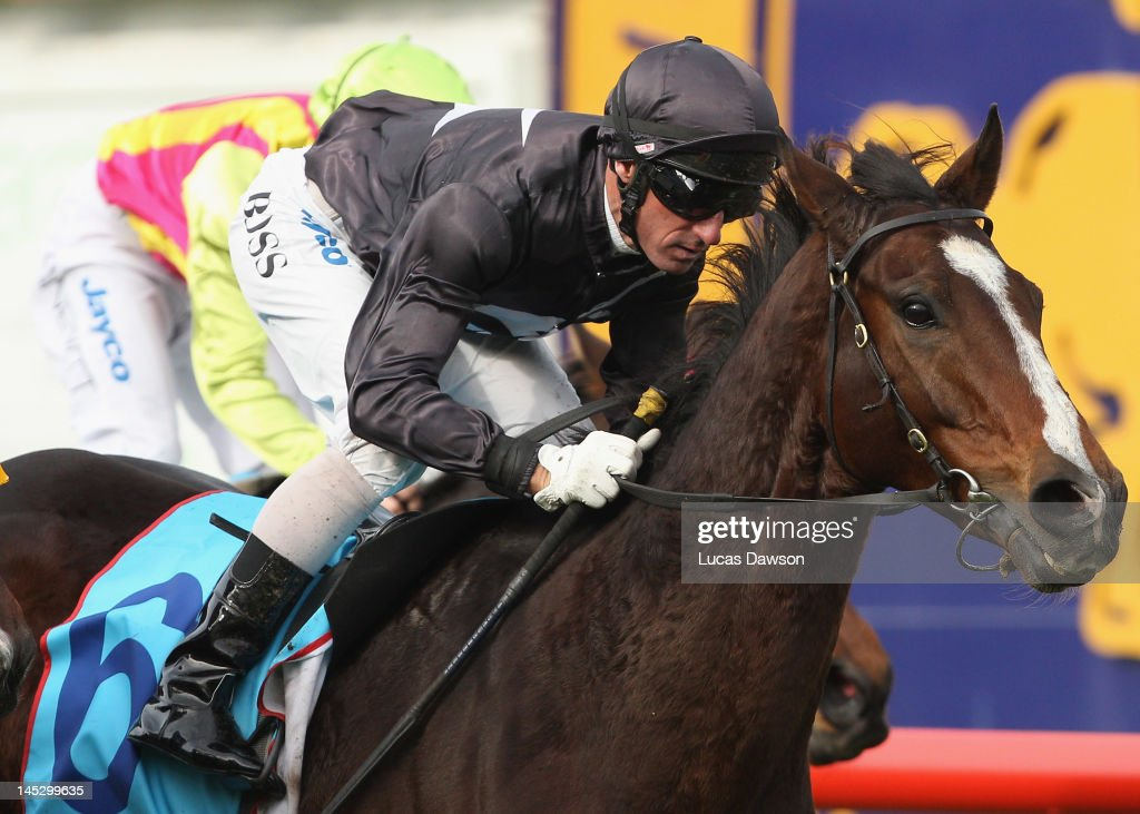 Jockey <a gi-track='captionPersonalityLinkClicked' href=/galleries/search?phrase=Glen+Boss&family=editorial&specificpeople=194758 ng-click='$event.stopPropagation()'>Glen Boss</a> riding Montgomery wins Race 3 Aldgate Lawyers Handicap at Taralye Race Day at Caulfield Racecourse on May 26, 2012 in Melbourne, Australia.