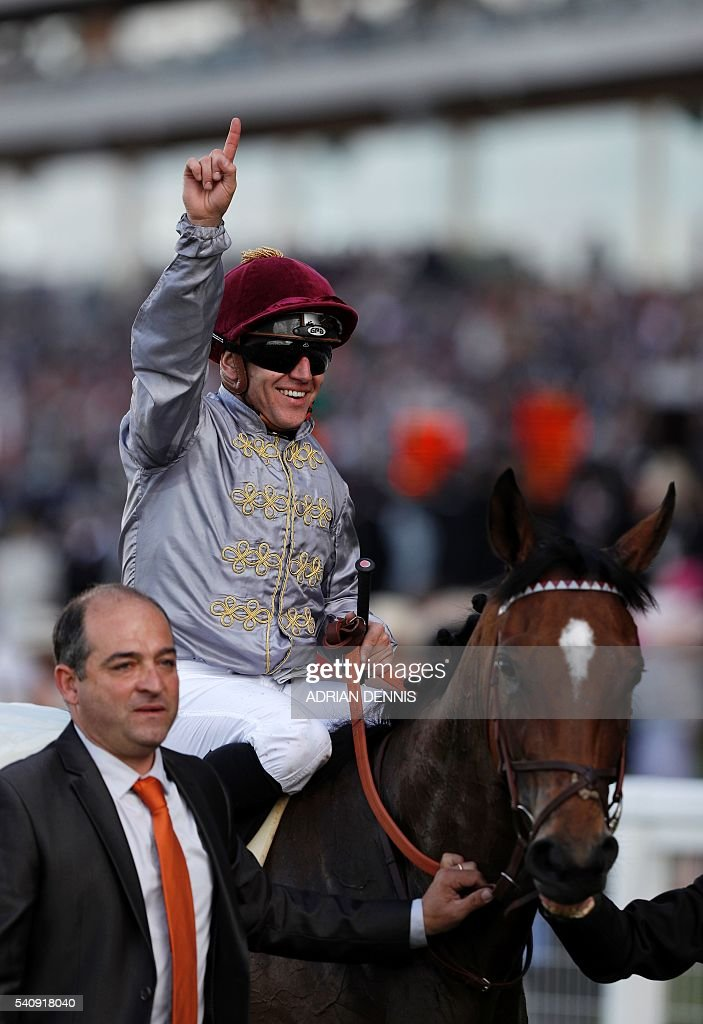 Jockey Gregory Benoist celebrates after riding Qemah to victory to win The Coronation Stakes group 1 race during day four at Royal Ascot horse racing...