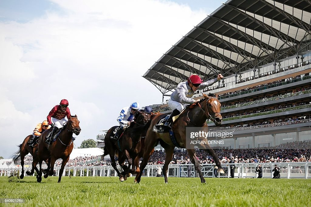 Jockey Gregory Benoist celebrates as he rides Qemah to victory to win The Coronation Stakes group 1 race during day four at Royal Ascot horse racing...