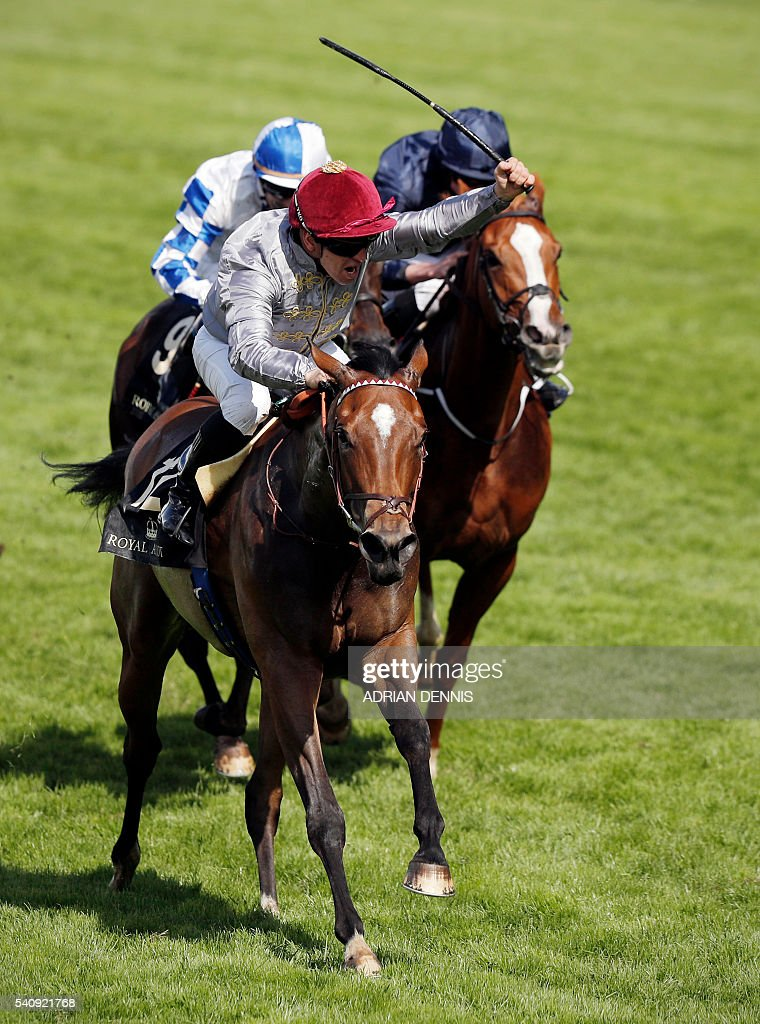 Jockey Gregory Benoist rides Qemah to victory to win The Coronation Stakes group 1 race during day four at Royal Ascot horse racing meet in Ascot...
