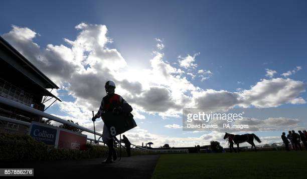 Jockey James Best makes his way in after the WhitesBuyers Of All Scrap Metal Maiden Hurdle at Warwick Racecourse