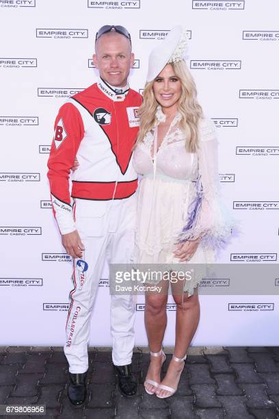 Jockey Jason Bartlett and TV Personality Kim Zolciak attend as Kim Zolciak hosts the Kentucky Derby hat contest at Empire City Casino at Yonkers...