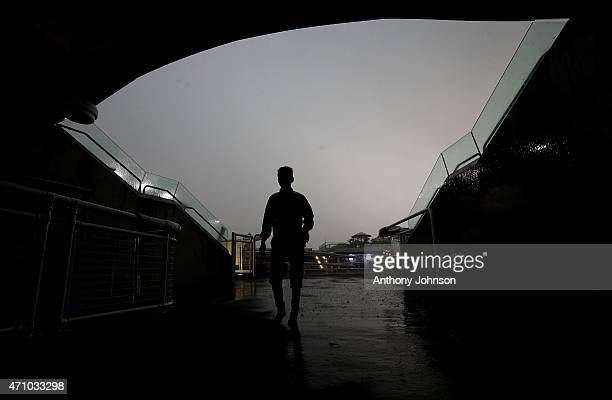 Jockey Jason Collett watches the storm roll in before an abandoned race 8 during Sydney Racing at Royal Randwick Racecourse on April 25 2015 in...
