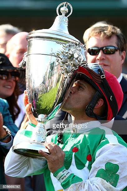 Jockey Javier Castellano celebrates by kissing the trophy after Cathryn Sophia crossed the finish line to winning the 142nd running of the Kentucky...