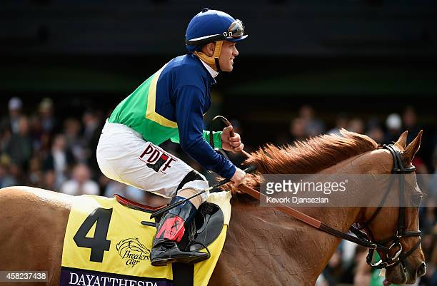 Jockey Javier Castellano smiles atop Dayatthespa after winning the 2014 Breeders' Cup Filly and Mare Turf at Santa Anita Park on November 1 2014 in...