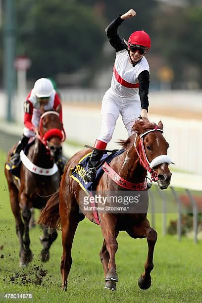 Jockey Jeane Alves celebrates as she guides Braco Forte after crossing the finish line to win the Grande Premio Jockey Club Brasileiro at Jockey Club...