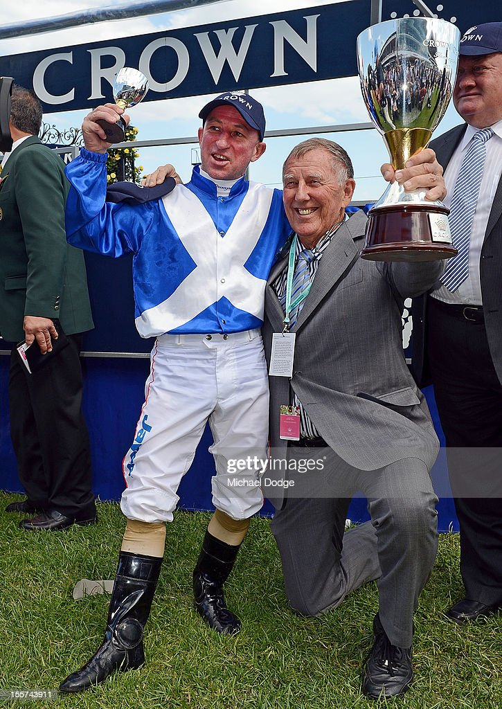 Jockey Jim Cassidy and owner John Singleton of Dear Demi, pose with the Crown Oaks trophy after winning the Crown Oaks during 2012 Crown Oaks Day at Flemington Racecourse on November 8, 2012 in Melbourne, Australia.