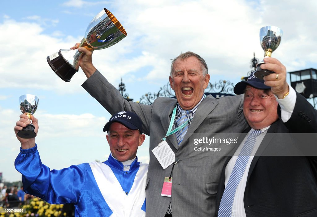 Jockey Jim Cassidy, owner John Singleton and trainer Clarry Conners pose with the Crown Oaks trophy during 2012 Crown Oaks Day at Flemington Racecourse on November 8, 2012 in Melbourne, Australia.