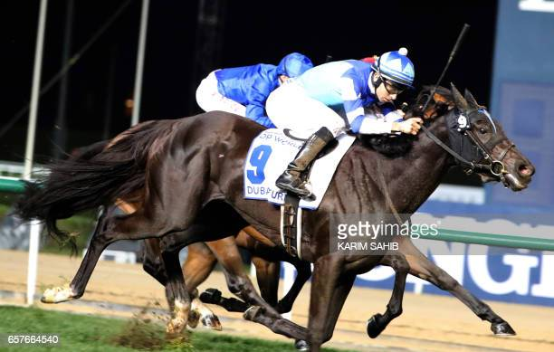 Jockey Joao Moreira ride of Vivlos to win the Dubai Turf at the Dubai World Cup in the Meydan Racecourse on March 25 2017 in Dubai / AFP PHOTO /...