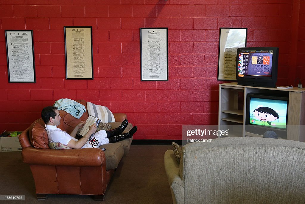 Jockey Joe Bravo relaxes prior to a race before the 140th running of the Preakness Stakes at Pimlico Race Course on May 16 2015 in Baltimore Maryland