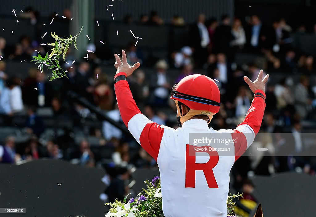 Jockey <a gi-track='captionPersonalityLinkClicked' href=/galleries/search?phrase=Joel+Rosario&family=editorial&specificpeople=6495860 ng-click='$event.stopPropagation()'>Joel Rosario</a> celebrates atop Bobby's Kitten after winning the 2014 Breeders' Cup Turf Sprint at Santa Anita Park on November 1, 2014 in Arcadia, California.