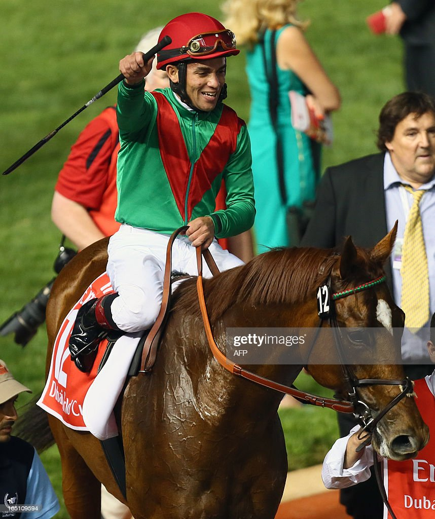 Jockey Joel Rosario jubilates after leading Animal Kingdom to win the 10 million dollar Dubai World Cup, the world's richest race, at Meydan race track in Dubai March 30, 2013. The 2011 Kentucky Derby winner (11/2), trained by American Graham Motion and ridden by Joel Rosario, beat home English raider Red Cadeaux by two lengths while another English-trained runner Planteur was third.