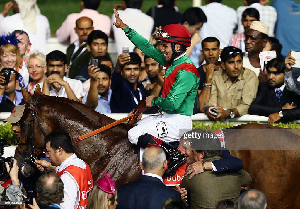 Jockey Joel Rosario jubilates after leading Animal Kingdom to win the 10 million US dollar Dubai World Cup, the world's richest race, at Meydan race track in Dubai March 30, 2013. The 2011 Kentucky Derby winner (11/2), trained by American Graham Motion and ridden by Joel Rosario, beat home English raider Red Cadeaux by two lengths while another English-trained runner Planteur was third.